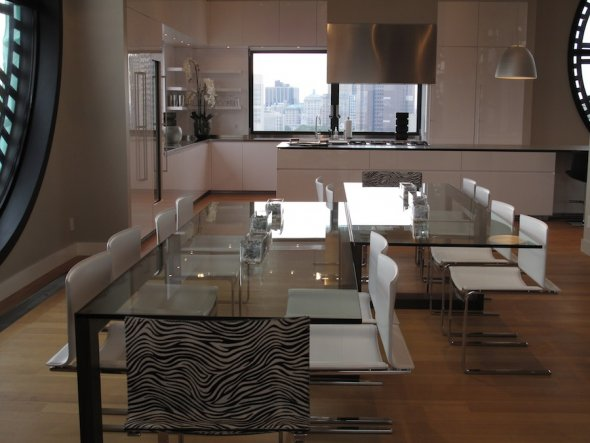 open floor plan with two dining tables